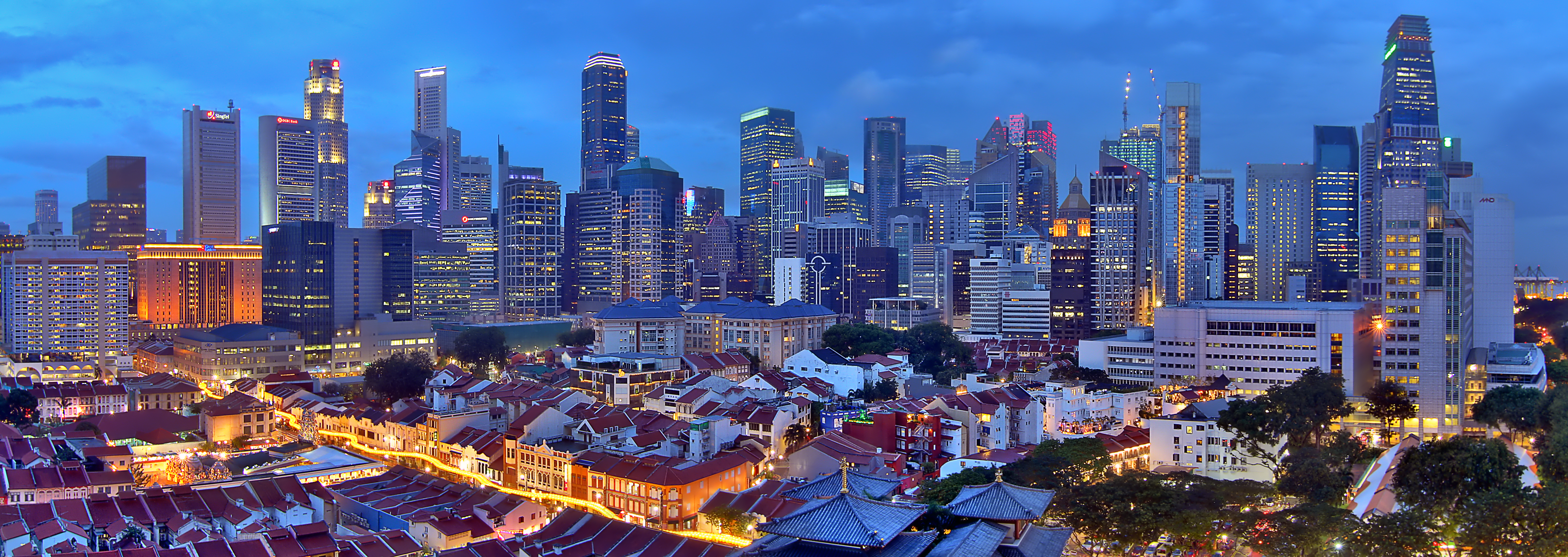 Singapore_skyline_from_Chinatown_at_blue_hour_(8463911183)